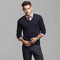 Adding a tie to a simple button up and sweater makes the difference.  Now he's sexy sleek and ready for work or play.