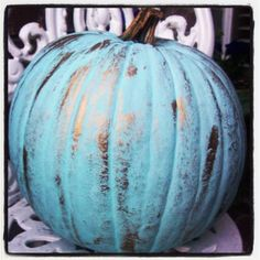 One locally grown pumpkin, 4 dollars, one bottle Robins Egg Blue acrylic paint, 99 cents, one tube Grecian Gold Rub and Buff, 2 dollars (only used one or two squirts, so plenty left for other projects) = Very Pretty Pumpkin for the front porch!
