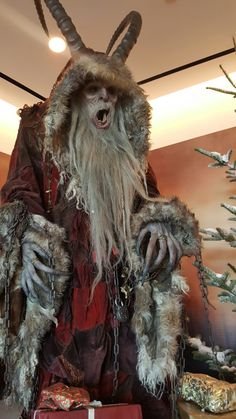Krampus. according to 95 year old grandmother would follow Santa around giving out coal to the naughty children :) Santa didn't look like the coke cola Santa we know today...this picture looks like a combination of both, Krampus and the old style Santa.
