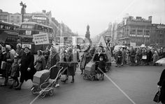 See more photos like this at http://www.irishphotoarchive.ie/ Housewives march in protest at the introduction of Turnover Tax, a new sales tax. The garda wearing white gloves in a raised booth to the centre right of the picture directed traffic on O'Connell Bridge. .14.11.1963. #vintage #oldphotos #blackandwhite #film #artistic #finearts #ireland #irishhistory #historyphoto #history