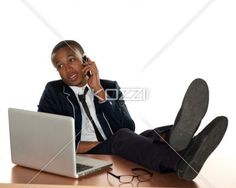 businessman with feet up - Shot of businessman with feet on desk.