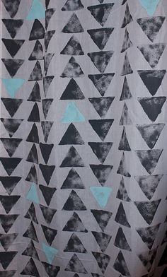 Hand stamped tribal triangle curtains.