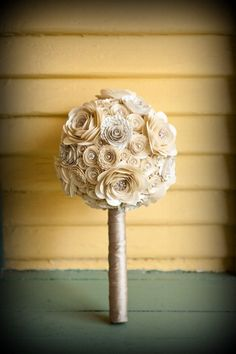 Probably a styrafoam ball pined with flowers, add larger ones to make it less round, easy. elegant spiral paper flowers wedding bouquet