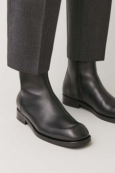 A minimal design, these ankle boots are made from smooth leather with a structured quality. Secured with discreet side zips, they have stacked heels, leather soles and raised square-cut toes. Leather Flip Flops, Flip Flop Shoes, Leather Accessories, Black Ankle Boots, Slip On Sneakers, Cow Leather, Smooth Leather, Leather Sandals