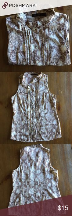 Snakeskin Print Blouse This is a versatile piece for the working woman. Button front. Sleeveless. •No returns, no trades •10% discount on 3+ items The Limited Tops Blouses