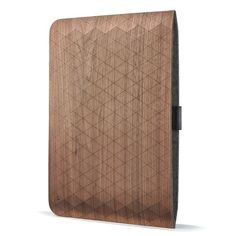 Handcrafted walnut veneer sleeve with geometric contouring for MacBook Air. Created by Grovemade.