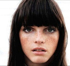 blunt bangs and freckles