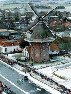Elfstedentocht 1997. The tour, almost 200 km in length, follows a route along frozen canals, rivers and lakes visiting the eleven historic Frisian cities: Leeuwarden, Sneek, IJlst, Sloten, Stavoren, Hindeloopen, Workum, Bolsward, Harlingen, Franeker, Dokkum, then returning to Leeuwarden