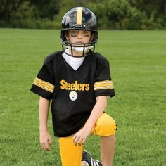 NFL® Deluxe Uniform Set - Pittsburgh Steelers - Your little football fan can look like a real gridiron warrior wearing this official NFL® uniform set! Included is an official home team jersey, team helmet with authentic logo and team colors and team pants that will have them looking ready to take the field. The set also includes iron-on numbers (0-9) for the back of the jersey. Makes a great Halloween costume! - See more at: http://franklinsports.com/shop/nfl-deluxe-uniform-set