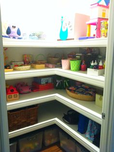 Organised craft/toy cupboard