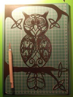 Original, hand drawn, 'Celtic owl' papercut. By Nina Byers