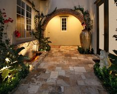 Love the stone and especially foliage for softness by AMS Landscape Design Studios, Inc.