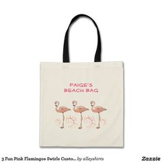 Custom name pink flamingos and swirls summer beach tote bag. These beautiful birds are standing 3 in a row with their necks curved. Jazzy pink swirls with small hearts as leaves curve between each flamingo for a burst of color at their feet. Easily add your name to create a unique personalized bag.