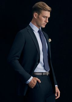 Fabric: Super 100's Pure Australian Merino Wool Body Fit: Slim Colour: Navy with Tonal mini check  The Brighton is a visually softer interpretation of the Anthony Squires suit featuring wider lapels and a more natural shoulder line, with sufficient structure to drape beautifully and wear exceptionally well.