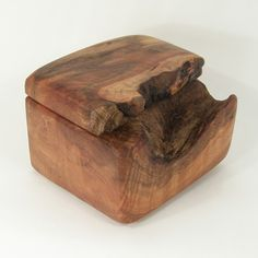 Maple.. love how the knot in the wood was left and used as part of the box. soo cool..