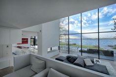 Casa de cristal junto al Lago / BBSC Architects