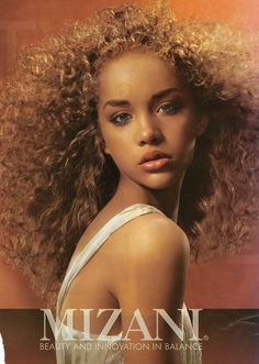 I don't care much for Mizani products (I don't like the scent) but this model. Is. Stunning. And her hair is so lovely.
