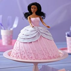 This glamorous doll cake makes her debut and makes a memory for the birthday girl that will live forever!