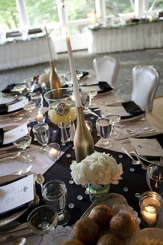 Purty wine bottle centerpieces  http://www.beautyretailers.com/