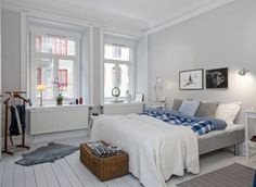 Bedroom:Fetching Scandinavian Interior Design Bedroom Furniture Ideas With Bedstead And Pillows Plus White Blanket Feat Table Lamps And Wall Lamps Also Windows Then Mat And Gray Fur Rugs With Wooden Floor Scandinavian Interior Design Bedroom Ideas