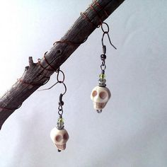 Skull earrings with green beads by CrowsdanceDesigns, $15.00 USD