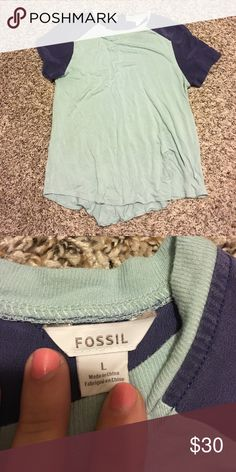 Colorblock Fossil short sleeve Adorable Fossil color block short sleeve in the perfect colors for spring time! Fits smaller, manufacturers tag says L, I wear size small but I like things loose in fit Fossil Tops Tees - Short Sleeve