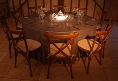 Pinspot lighting to terrarium vase table centre, silver matte sequin tablecloth and crossback chairs with soft burlap cushions for a rustic barn wedding at Upwaltham Barns by www.stressfreehire.com #venuetransformers