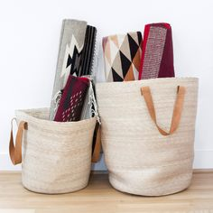 Braided with palm leaves from Southern Mexico and topped with soft leather handles, this basket is light and flexible without sacrificing durability. It's a great way to de-clutter your space and keep blankets, toys and other necessities organized.