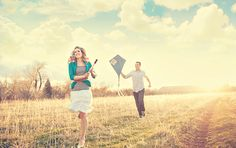 I love the lighting and the big puffy clouds. Flying a kite is such a great idea for an engagement shoot! eeh