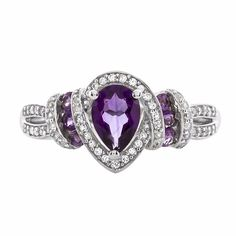 Amethyst ring with one 7x5 millimeter pear shaped amethyst, four 2x2 millimeter round amethyst, two 1.75x1.75 millimeter round amethyst and sixty five lab-created round white sapphires