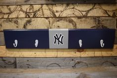 A personal favorite from my Etsy shop https://www.etsy.com/listing/469964415/new-york-yankees-4-hook-hat-coat-rack