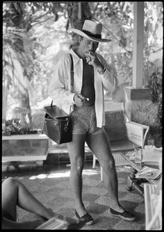 John Wayne...nice legs...you have to be one confident man to pull those shorts and shoes off and a camel toe...go duke!