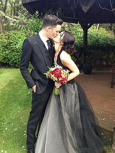 90210 star, Shenae Grimes and her British model husband, Josh Beech. Her gown was from Vera Wang's 2012 fall collection which featured all black gowns. What say you on the black gown; yay or nay?