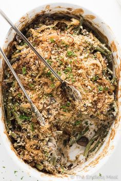 Healthy Vegan Green Bean Casserole is made with a delicious dairy-free mushroom sauce and topped with crunchy onions and is every bit as delicious as a regular green bean casserole, but so much healthier. It's perfect for Easter, Christmas or Thanksgiving dinner. You're going to love it! | theendlessmeal.com