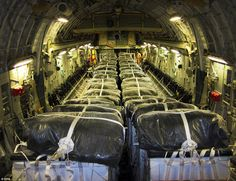 Support: This image released today by the U.S. Department of Defense shows pallets of bott...