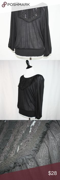 Free People Embellished Long Sleeve Top Black Top has lovely details on front. The fabric is textured on entire top.  Fitted waist band that can sit lower. Long sleeves with detail on backs of cuff. Great top for Fall and beyond!! Found a tiny hole in the fold on front. Free People Tops