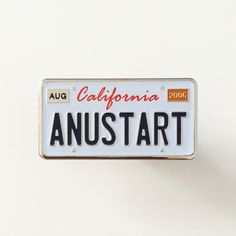 """Anustart+pin+inspired+by+Arrested+Development •+1.25""""+wide •+Stamped+on+silver-plated+nickel •+Printed+&+etched+detailing •+3.5""""+x+2""""+card+w/+cello+packaging •+Rubber+clasp"""