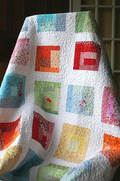 Pretty modified log cabin.  quilted quilt by cebbtn, via Flickr