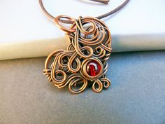 Copper Heart Pendant with Red Bead by adornjewels on Etsy pin to view later. Click to buy