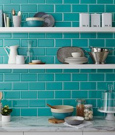 Teal tiles for a small bathroom to make it really impactful.