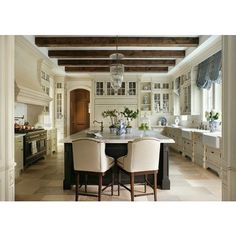 French country kitchen, exposed beams, double farm sinks, balloon valance, stone floors, marble counters...