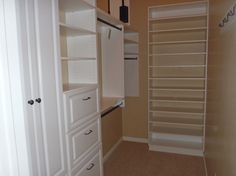 Long, narrow walk in closet with maximized space by Smart Space Design
