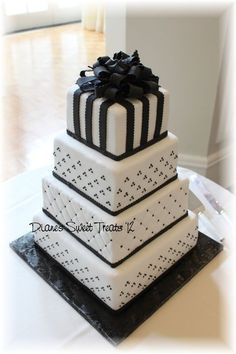 Black and White Wedding Cake, would be stunning with silver or ivory instead of black