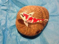 Hand painted rover rocks, these have beautiful koi fish painted directly on the rock and then are sprayed with a clear coat lacquer. Extremely cute and original! No two pieces are ever the same. They are perfect off the outdoors or your indoor terrarium.