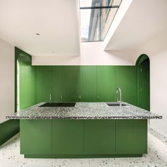 Ten home kitchens that use colour to make a statement Green Kitchen Island, Kitchen Colors, Terrazzo, Georgian Fireplaces, Tokyo Apartment, 1970s House, Yellow Cabinets, Wall Cabinets, Pink Tiles