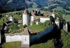 Gruyere Castle, Gruyere Switzerland. An enchanting place. We had raclette (sp?)  here. Boiled potatoes and cured meats that you dip in melted gruyere cheese. All of this plus beer, a medieval castle, the HR Geiger museum. Just like a fairy tale! 2001.