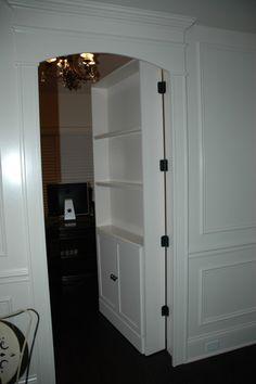 Secret room behind bookcase cabinet door