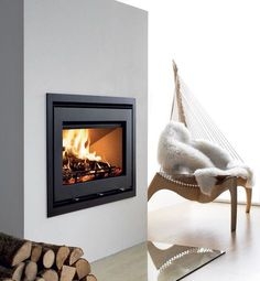 Terrific Absolutely Free White Fireplace with stove Popular Remember when I was hemming and hawing about whether to paint our fireplace white? Well, one night I Wood Burning Fireplace Inserts, Fireplace Logs, White Fireplace, Fireplaces, Wood Burning Stove Insert, Insert Stove, Modern Stoves, Grey Wood Floors, Home Library Design
