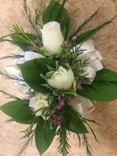 White spray rose and pink wax flower wrist corsages with Israeli ruscus, tree fern, and ivory ribbon #RosemaryBeachWedding #RosemaryBeachTownHall by #SunshineFlorist