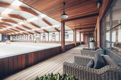 I love this idea of a lounge space by the ring. Perfect for investors or clients to watch their horses work.